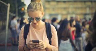Blonde girl using her smartphone
